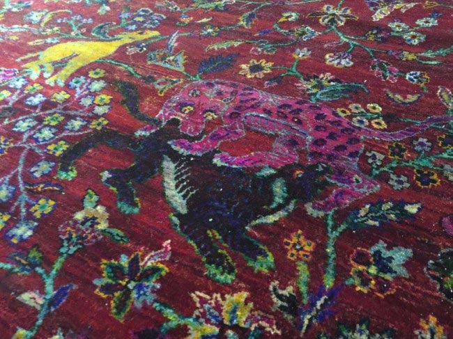 rug pattern with pink leopard attaching other leopard