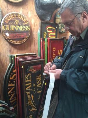 John Wingo adding stickers