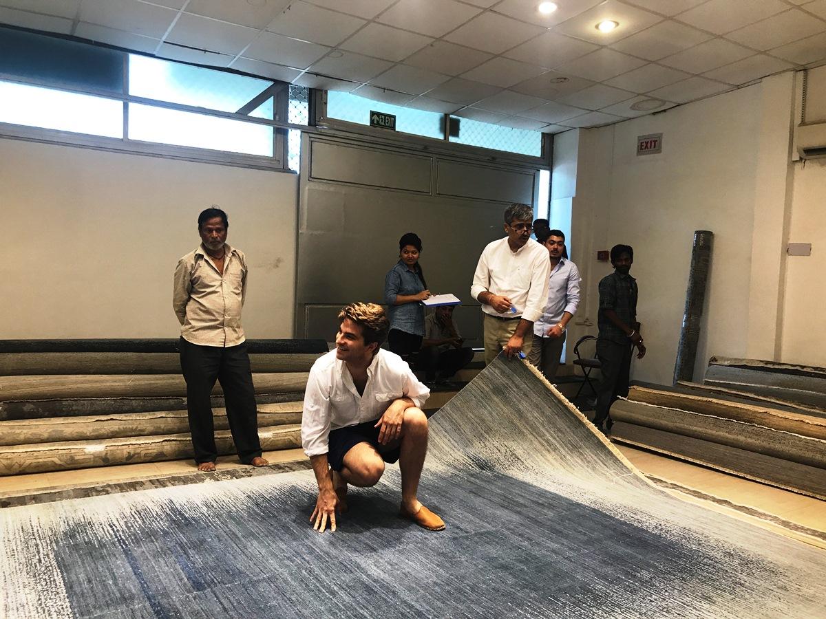 den selecting a massive rug