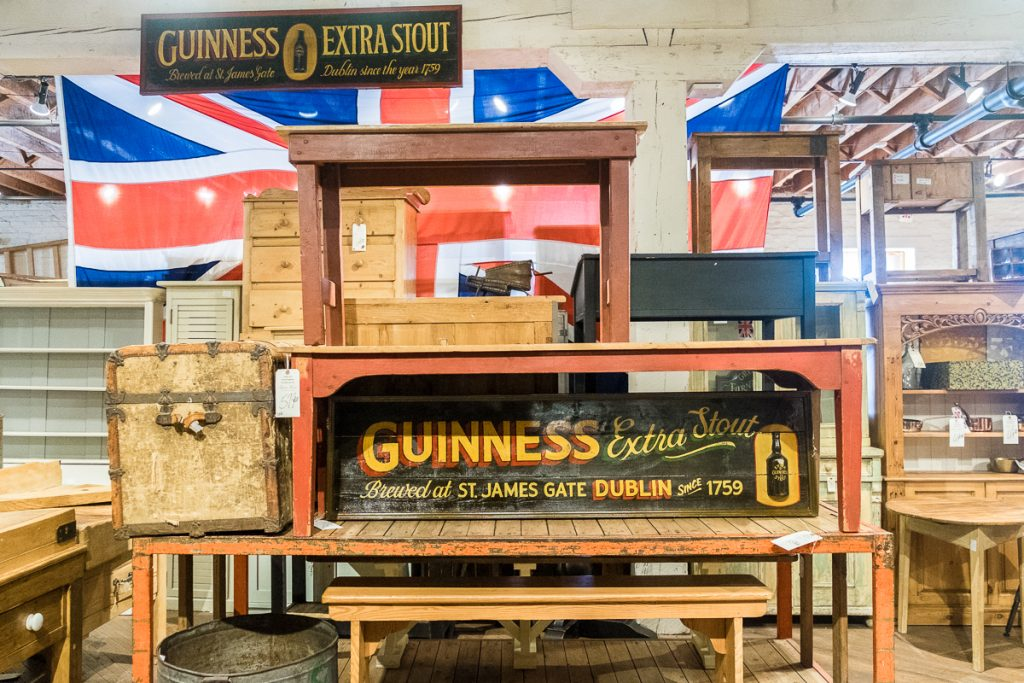 guinness extra stout sign on wood tables