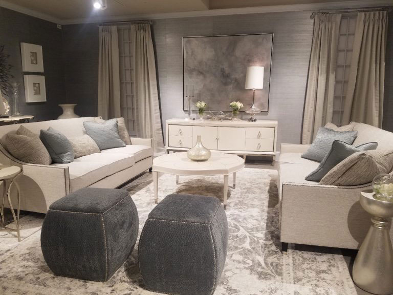 Bernhardt showroom filled with cream furniture and rugs and gray stools