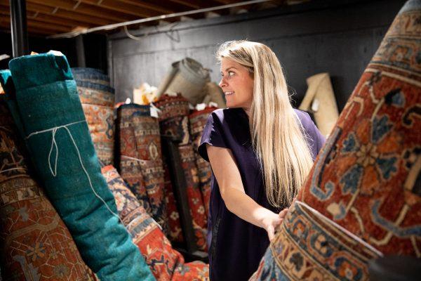 woman browsing rugs